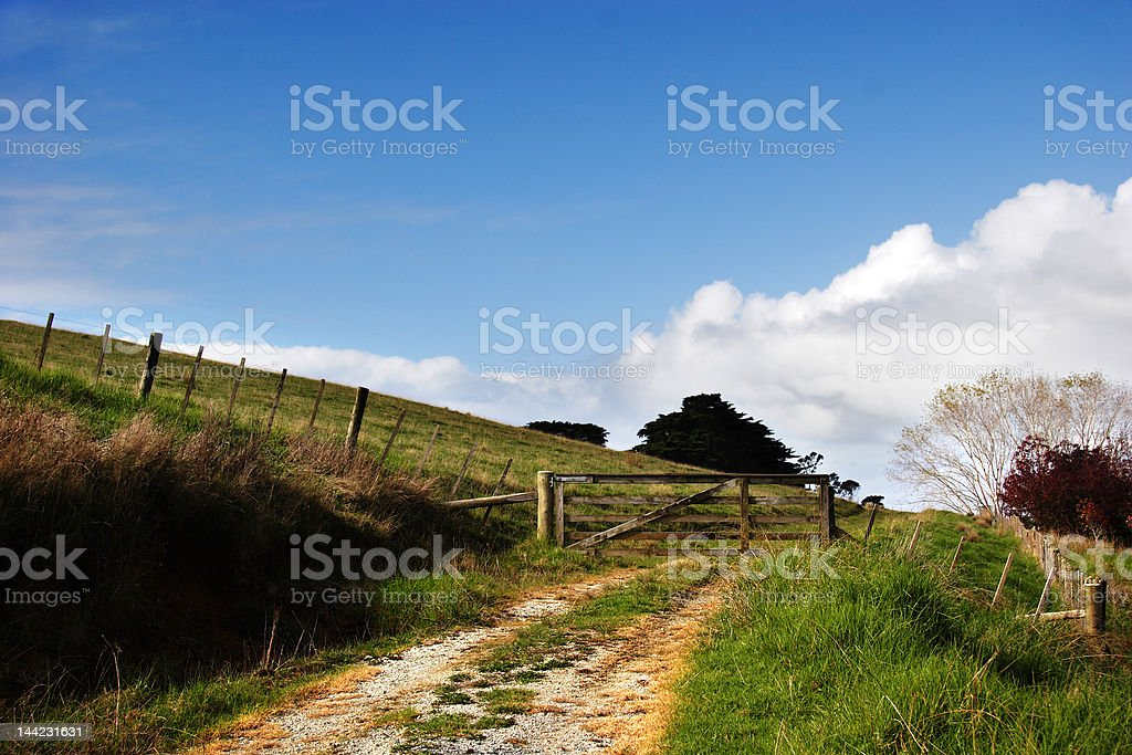 dirt track to farm gate stock photo