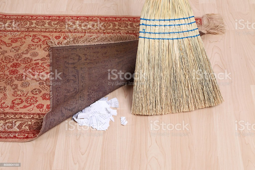 Dirt Under the Rug stock photo