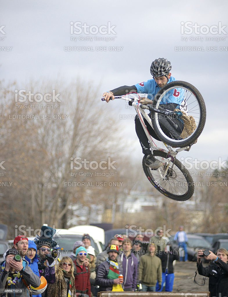 Dirt-jumper jumps over ramp at cycling event stock photo