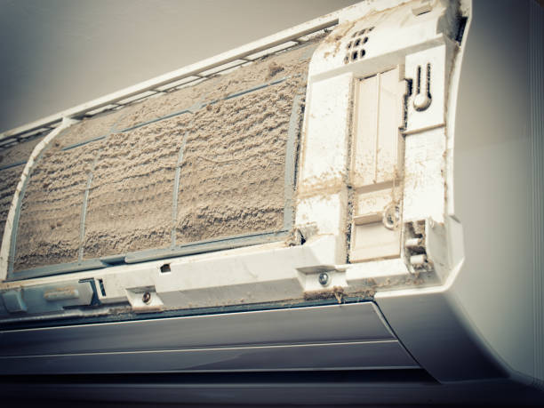Dirty air condition Closeup view of an open Air condition unit and very dirty air filters. air filter stock pictures, royalty-free photos & images
