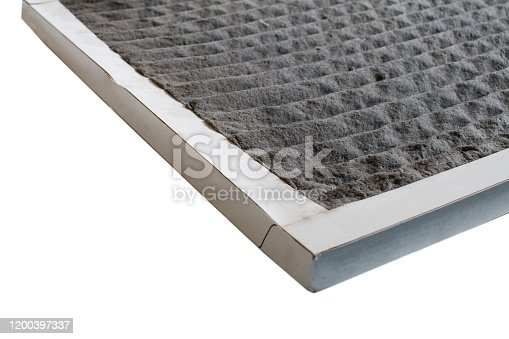 A dirty air conditioning filter on a white background.