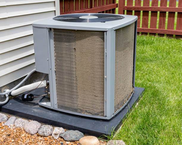 Dirty air conditioning unit before and after cleaning. Condensor coil full of dirt and grass debris. Concept of home air conditioning repair, service, cleaning and maintenance stock photo