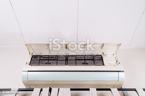 931591820 istock photo Dirty air conditioning unit full of dust dirt on filters 515915430