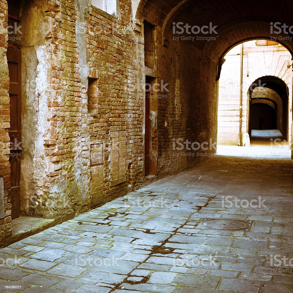 Dirty Alley with Archway in a Tuscan Village, Italy stock photo