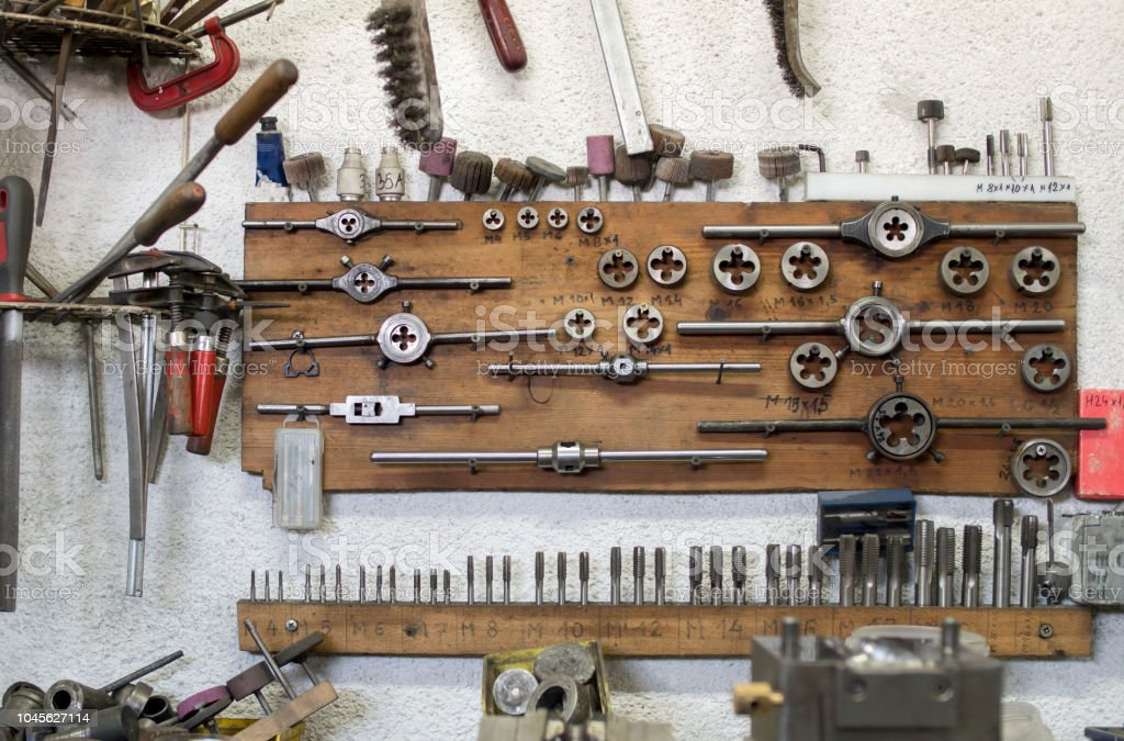 Dirty and arranged tools on the wall