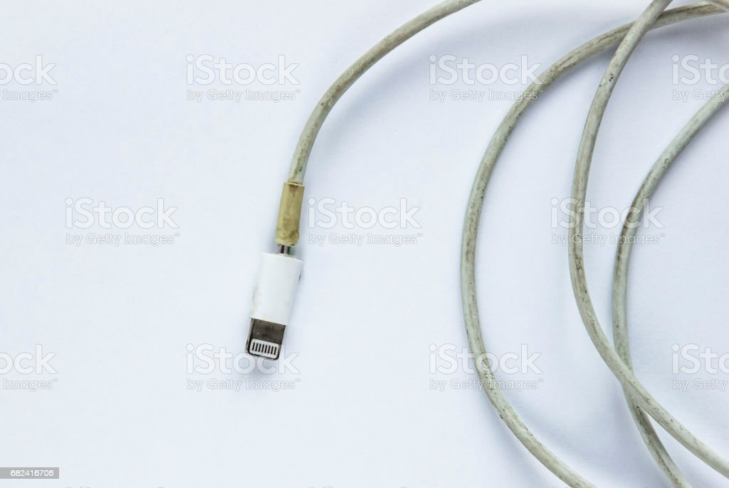 Dirty and broken charger cable royalty-free stock photo