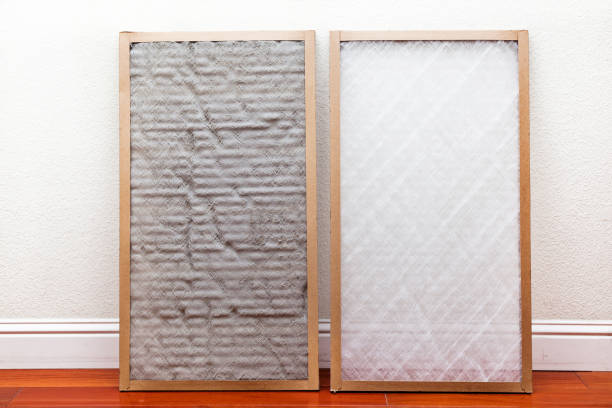 Dirty and Clean Air Conditioner Filters Old and New air conditioner filter next to each other leaning against the wall air filter stock pictures, royalty-free photos & images