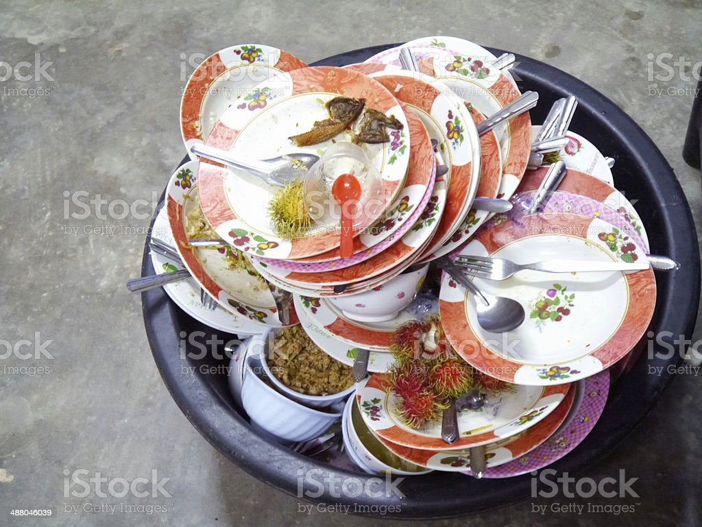 dirty and empty dishes stock photo