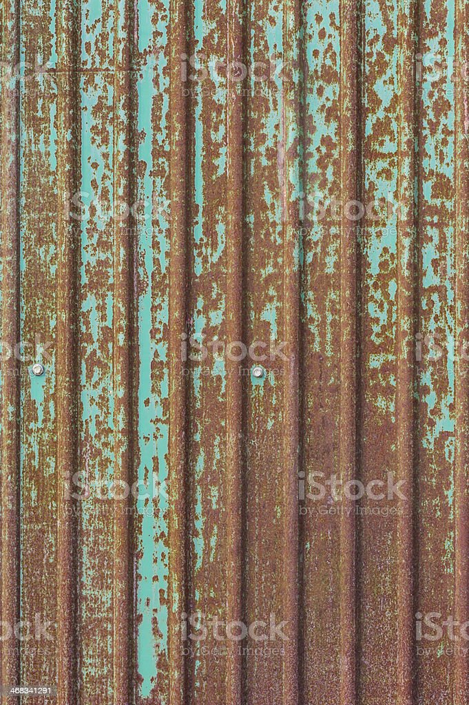dirty and rusty brown color on green zinc plate wall royalty-free stock photo