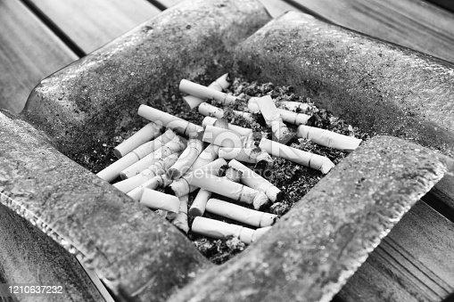 istock Dirty ashtray 1210637232