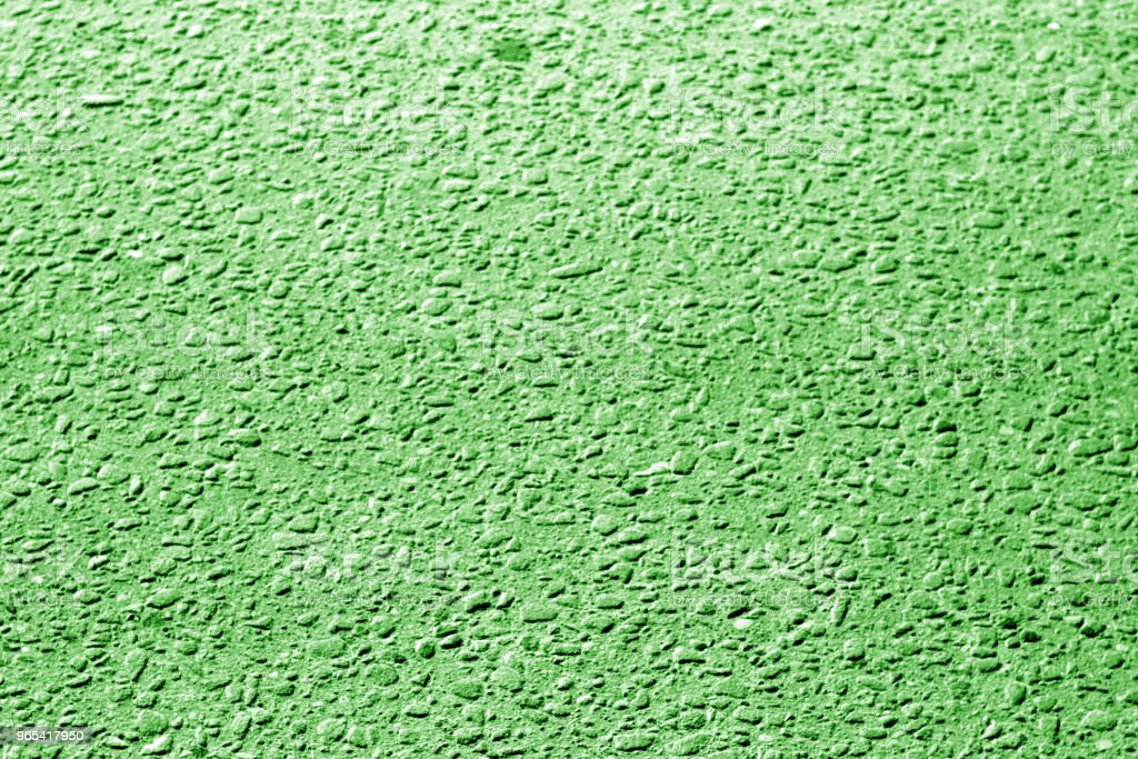 Dirty asphalt road texture with blur effect in green tone royalty-free stock photo