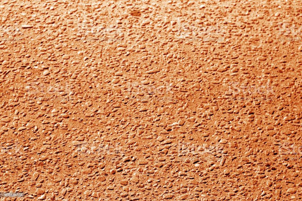 Dirty asphalt road texture with blur effect in orange tone. zbiór zdjęć royalty-free