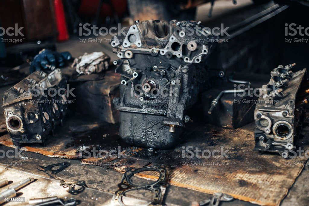 dirty auto engine in garage royalty-free stock photo