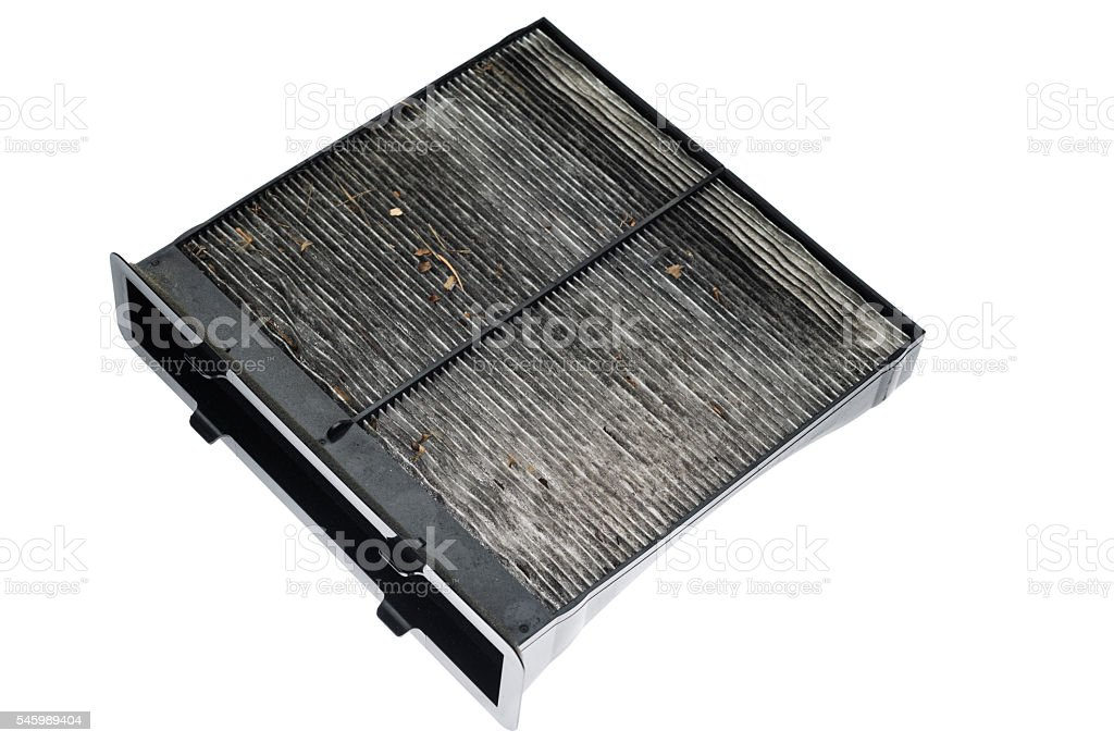 Dirty automobile interior cabin air filter on white background stock photo