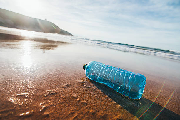dirty beach - ocean plastic stock pictures, royalty-free photos & images