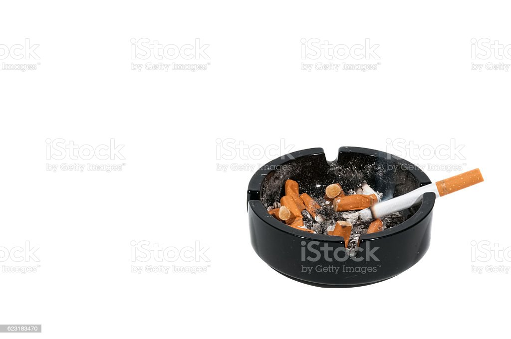 Dirty black ceramic ashtray with a cigarette – Foto