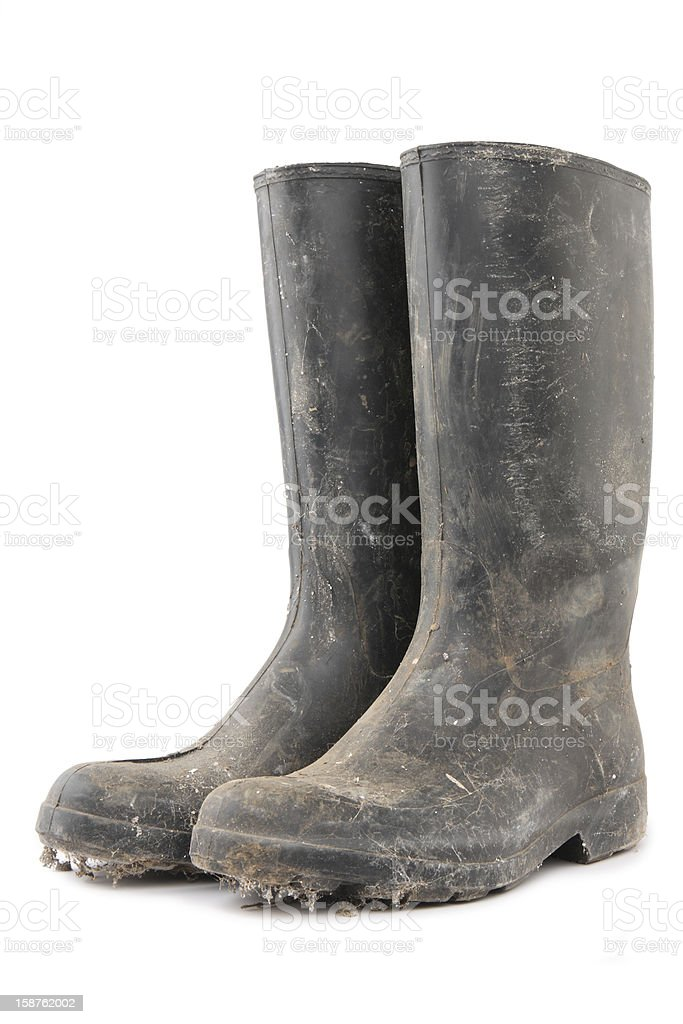 Dirty black gumboots on white background royalty-free stock photo