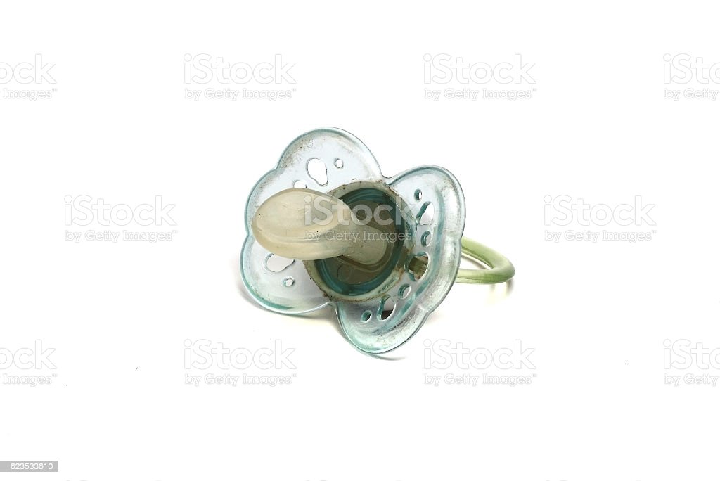 dirty blue pacifier on a white background stock photo