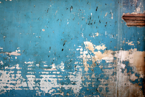 Dirty blue spattered wall background