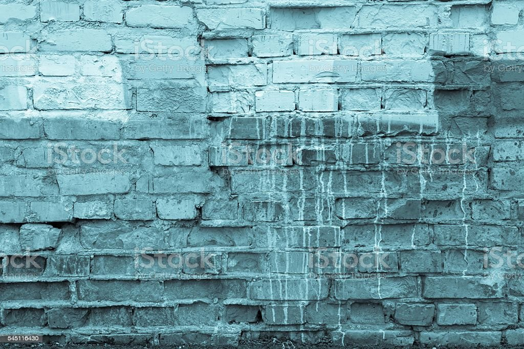 dirty blue texture of the destroyed brick wall stock photo
