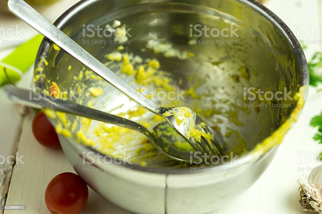 Dirty bowl after preparing guacamole. stock photo