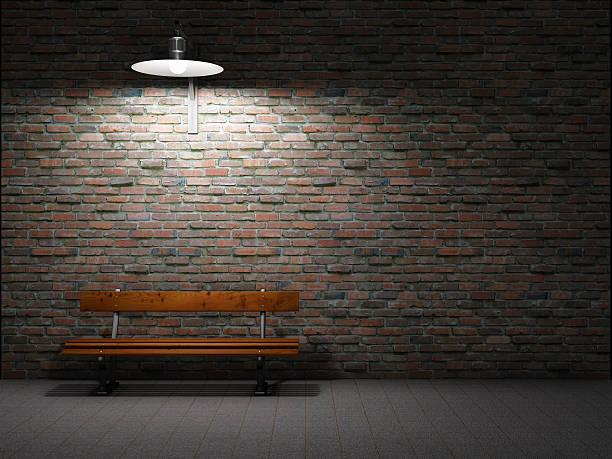 Dirty brick wall illuminated stock photo