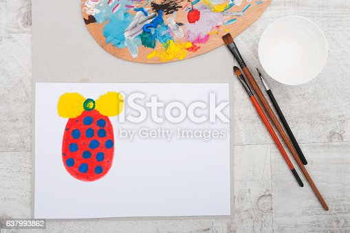 510006691 istock photo Dirty brushes with  art pallete and egg on paper 637993862