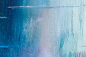 Dirty canvas, sackcloth or burlap with visible texture, brush strokes and spots. Abstract background