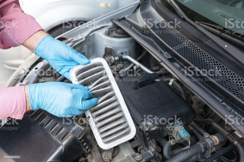 Dirty car engine air filter stock photo