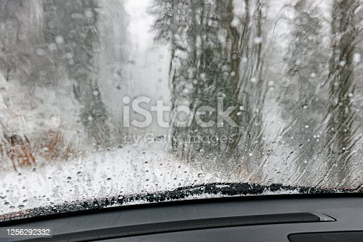 Dirty car windshield with included glass cleaner in the woods,Primorska, Slovenia ,Europe