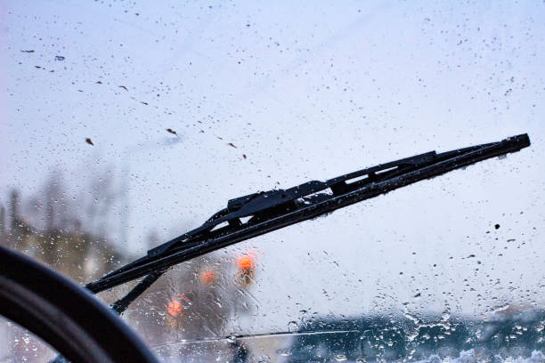 dirty car windshield with the included glass cleaner, in the big city front and back of the background is blurred dirty car windshield with the included glass cleaner, in the big city front and back of the background is blurred windshield wiper stock pictures, royalty-free photos & images