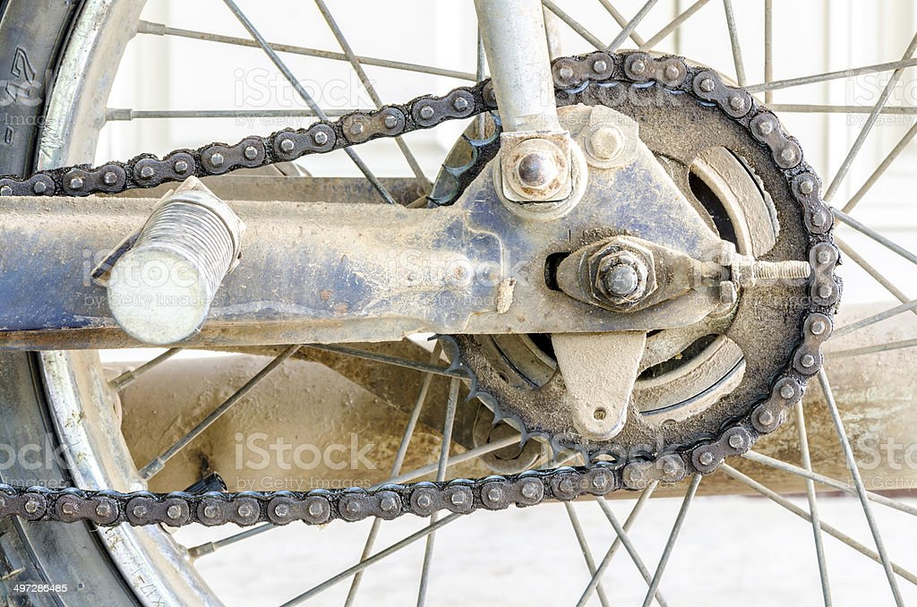 Dirty chain of old motorcycle's rear wheel stock photo