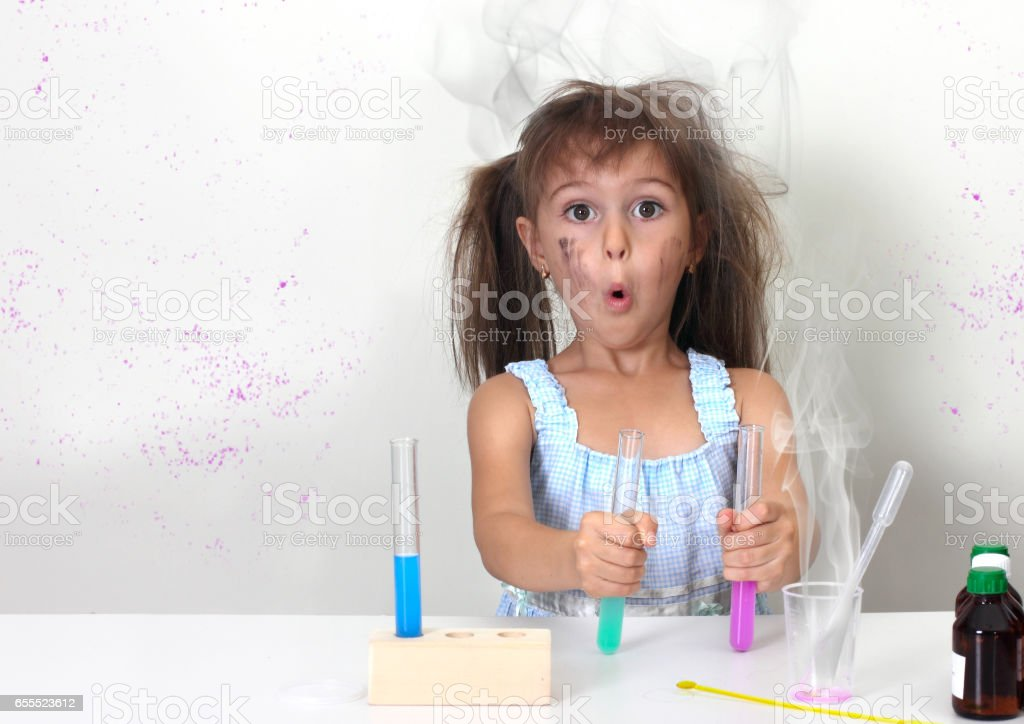 dirty child making unsuccessful explosive chemical experiment stock photo