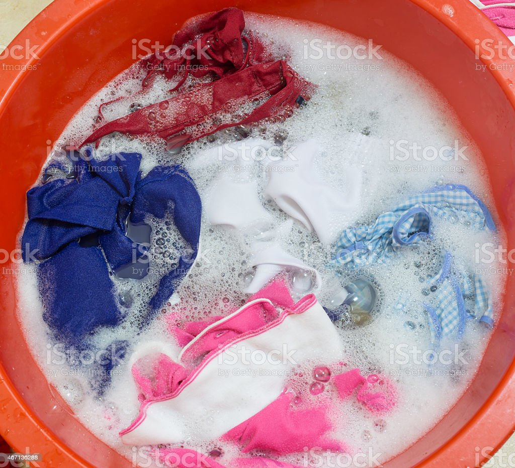 Dirty clothes soak in tub stock photo