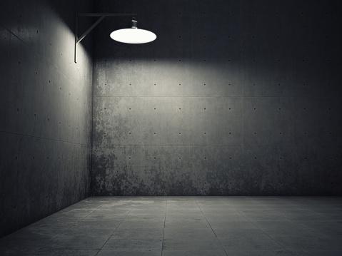 Dirty concrete wall illuminated