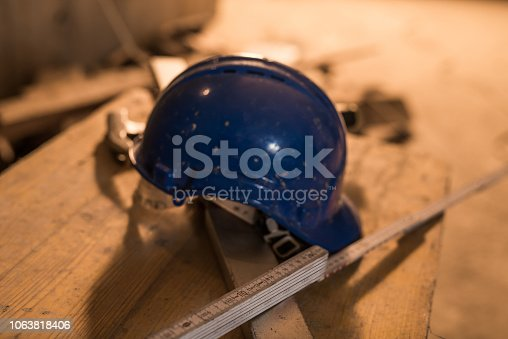 936384788 istock photo Dirty construction worker's equipment on a construction site. 1063818406