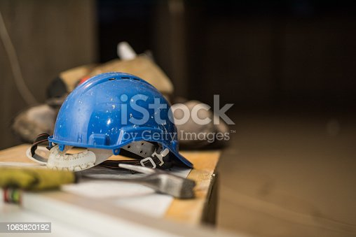 936384788 istock photo Dirty construction worker's equipment on a construction site. 1063820192