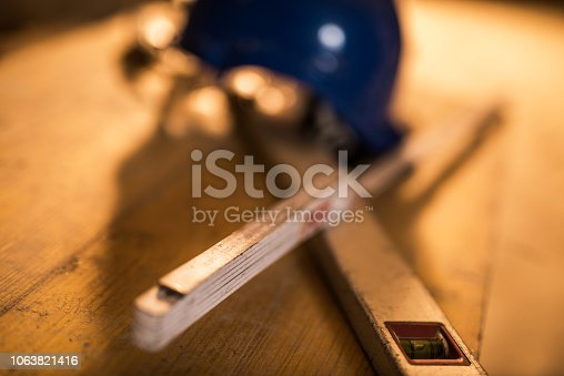 936384788 istock photo Dirty construction worker's equipment on a construction site. 1063821416