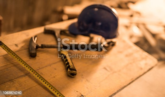 936384788 istock photo Dirty construction worker's equipment on a construction site. 1063824240