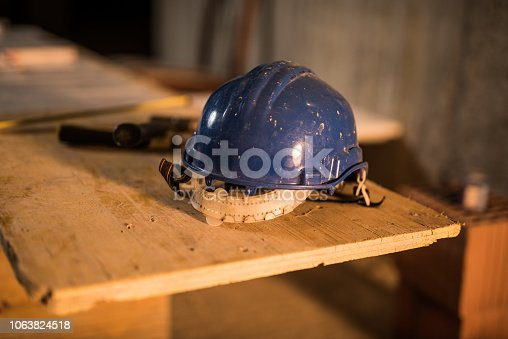 936384788 istock photo Dirty construction worker's equipment on a construction site. 1063824518