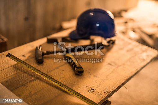 936384788 istock photo Dirty construction worker's equipment on a construction site. 1063825740
