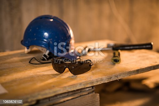 936384788 istock photo Dirty construction worker's equipment on a construction site. 1063826102