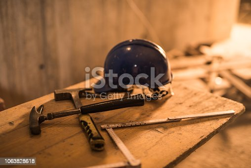936384788 istock photo Dirty construction worker's equipment on a construction site. 1063828618
