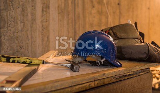 936384788 istock photo Dirty construction worker's equipment on a construction site. 1063829466