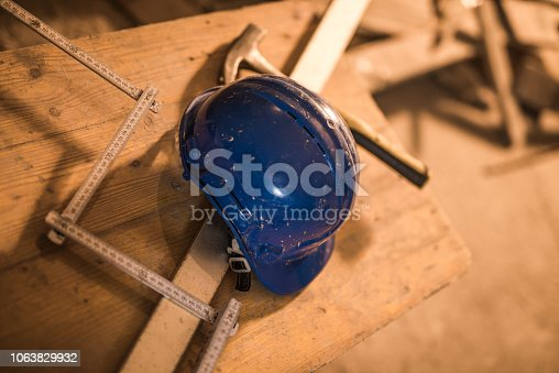 936384788 istock photo Dirty construction worker's equipment on a construction site. 1063829932