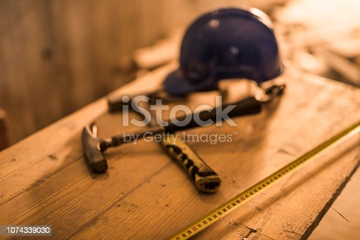 936384788 istock photo Dirty construction worker's equipment on a construction site. 1074339030