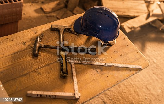 936384788 istock photo Dirty construction worker's equipment on a construction site. 1074348792