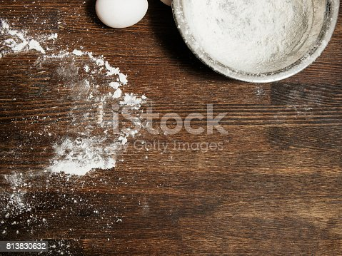 istock Dirty cooking table with flour and bowl 813830632
