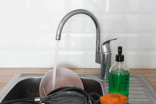 Dirty Dishes In Metal Kitchen Sink Running Tap Water Needing Washingup Cleaning Chores Professional Service Cleaning Up Concept Stock Photo Download Image Now Istock