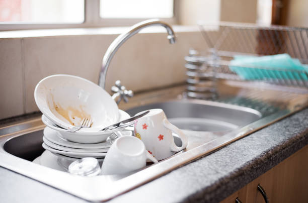 Dirty dishes in the sink Shot of kitchen sink full of dirty dishes crockery stock pictures, royalty-free photos & images